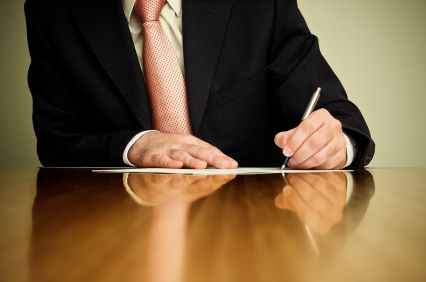 Businessman writing paper